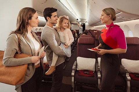 Qantas crew welcoming family on Dreamliner