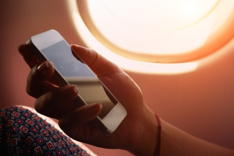 Women holding a iphone in cabin
