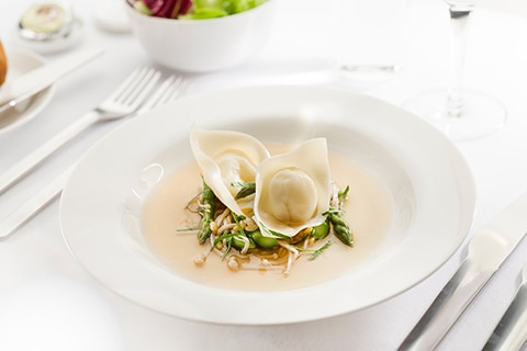Pumpkin tortellini with roast chicken broth asparagus - First class