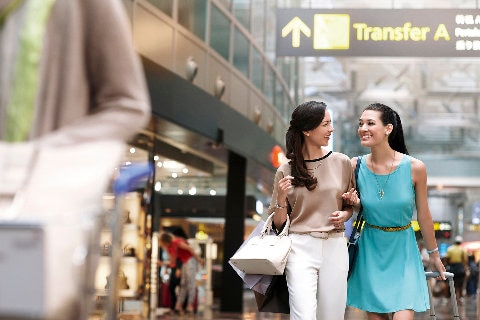 girls shopping together in Singapore airport