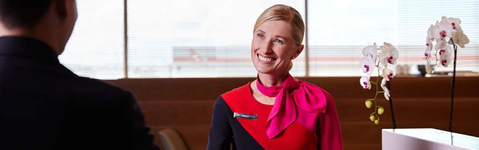 Qantas staff welcoming customer