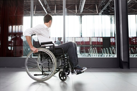Man using wheelchair through terminal