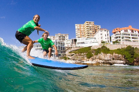 two-people-learning-to-surf-bondi