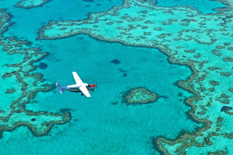 plane-flying-over-reef-island