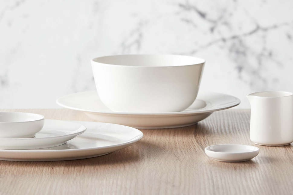 Crockery by Noritake, cutlery and glassware