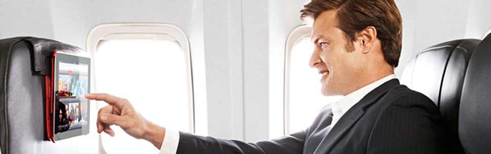 Business man on aircraft with inflight screen