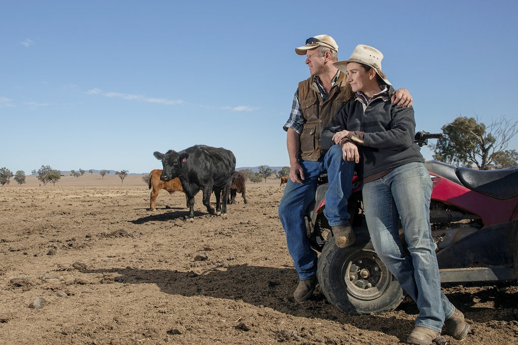Female and male farmers in the outback