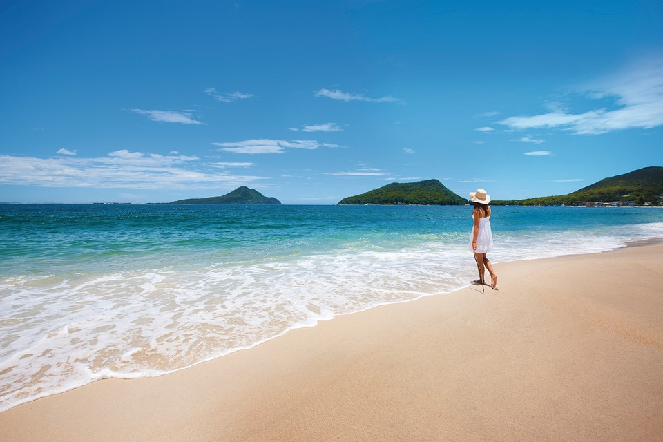 Woman enjoying the beach at Shoal Bay, Port Stephens, Australia