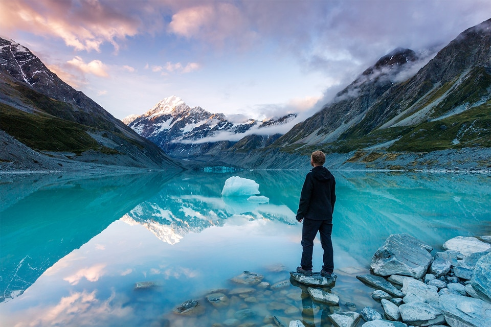 Hiker looking at Mt Cook, Hooker lake, New Zealand