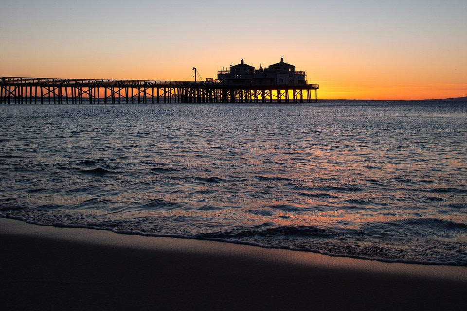 Malibu pier against sky during sunset
