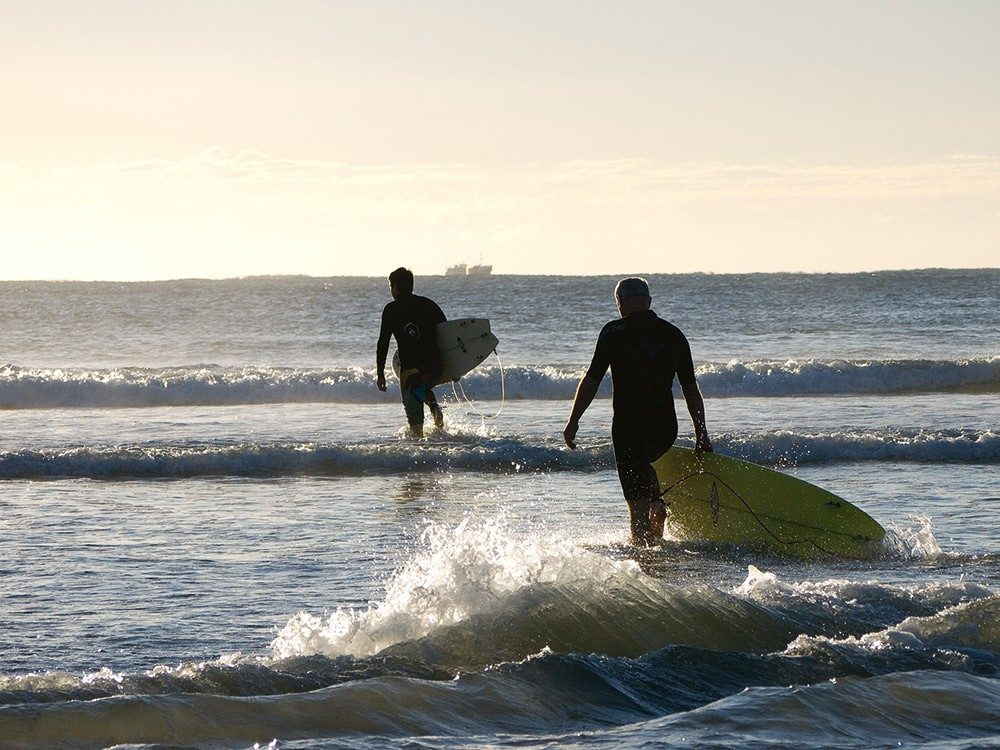 Surfers hit the waves at Sawtell Beach, NSW