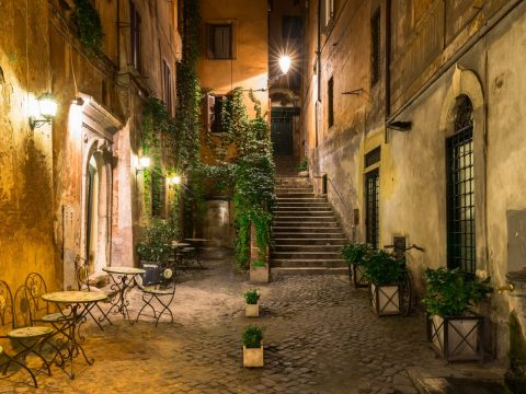 rome quiet laneway at night with vines