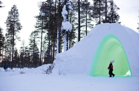 Exploring a snow igloo in Finland