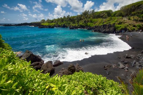 Wiggle your toes in black sand, Maui