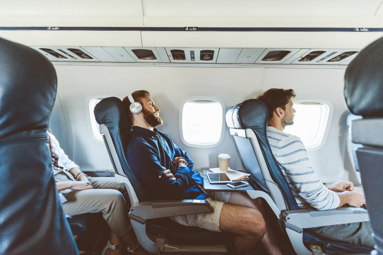 Expert tips for how to sleep on the plane