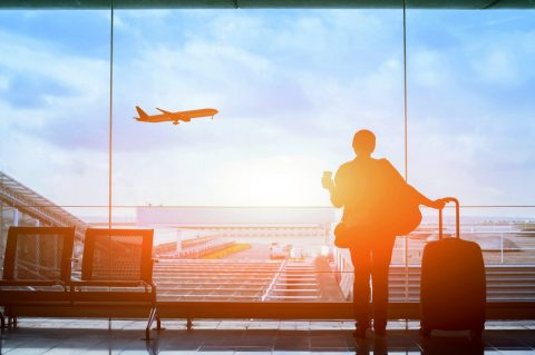Man standing at airport window