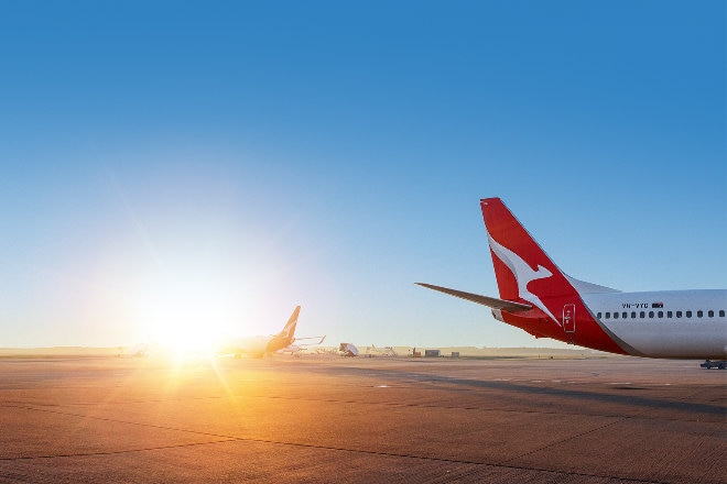 Qantas aircraft tails sunset