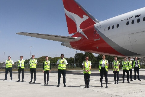 Students with a B787 at the Brisbane Base