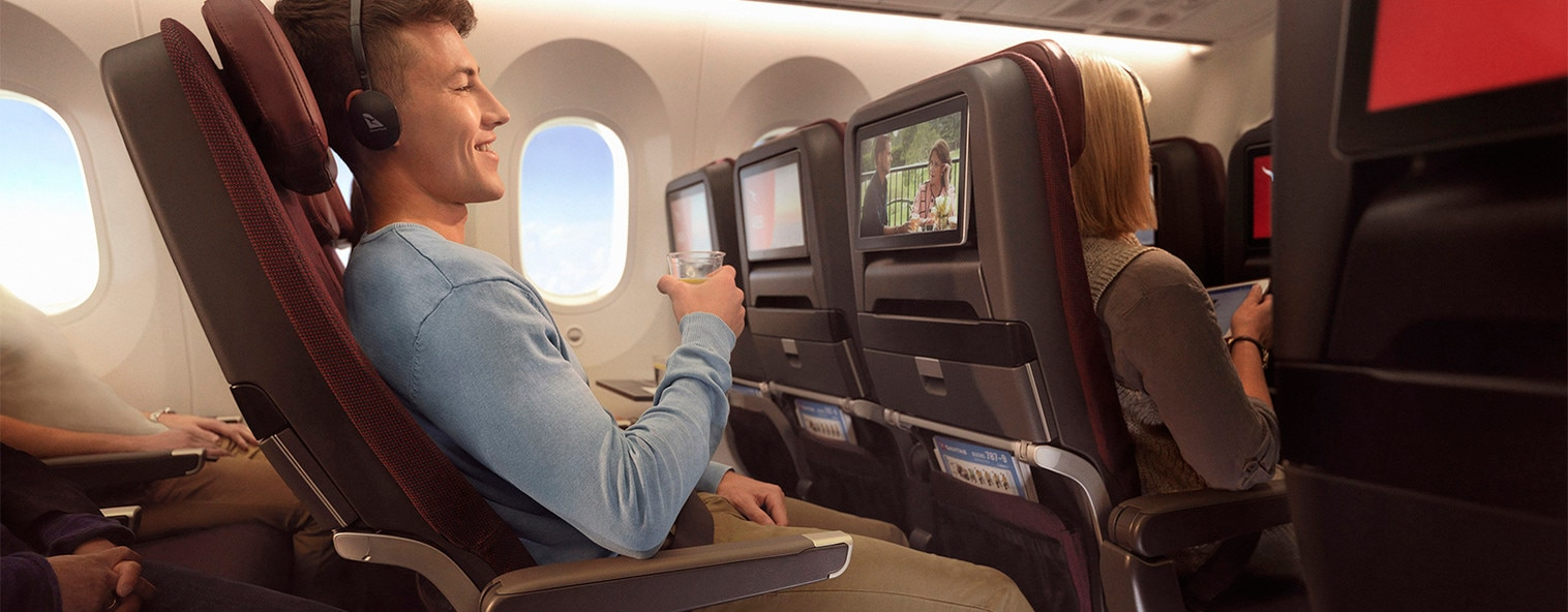 Dreamliner man in Economy cabin