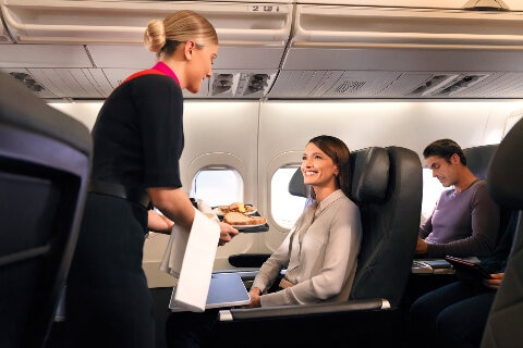 Lady enjoying business dining service on B717