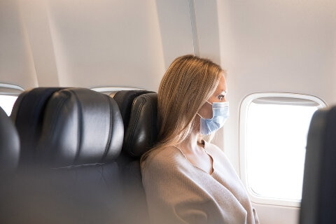 lady wearing a face mask on board
