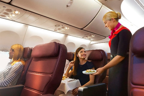 Lady serving food on qantas plane
