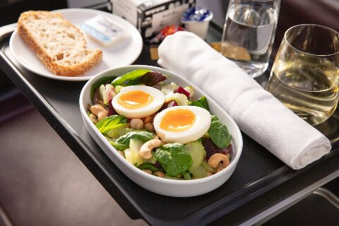 Domestic Business meal, egg and cashew salad with white wine