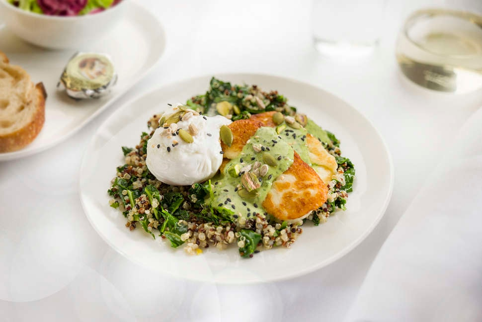 Poached eggs, kale quinoa and grilled haloumi with pistachios - Business