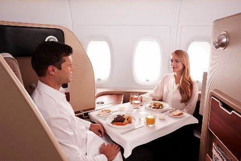Man and women dining in suite