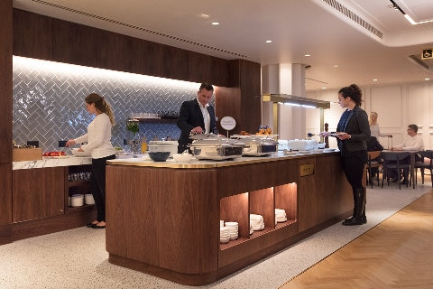 Business man at self serve food buffet in Qantas lounge