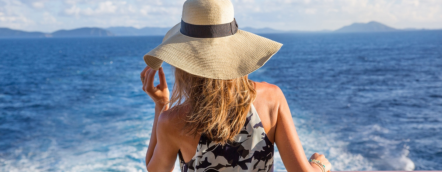 Woman in sunhat on cruise deck