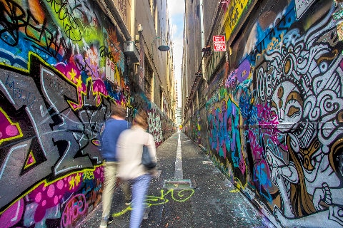 A couple taking in the laneways street art