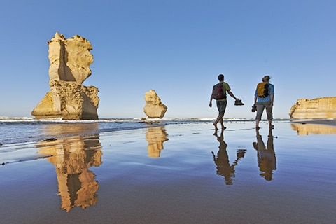 Couple walking on a beach in Victoria Australia