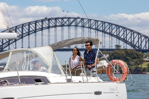 A couple sailing on a vessel at Sydney Harbour