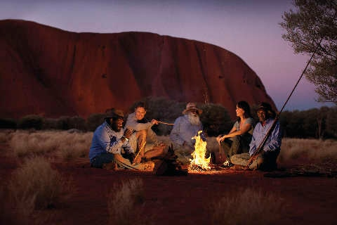 People around campfire at Uluru