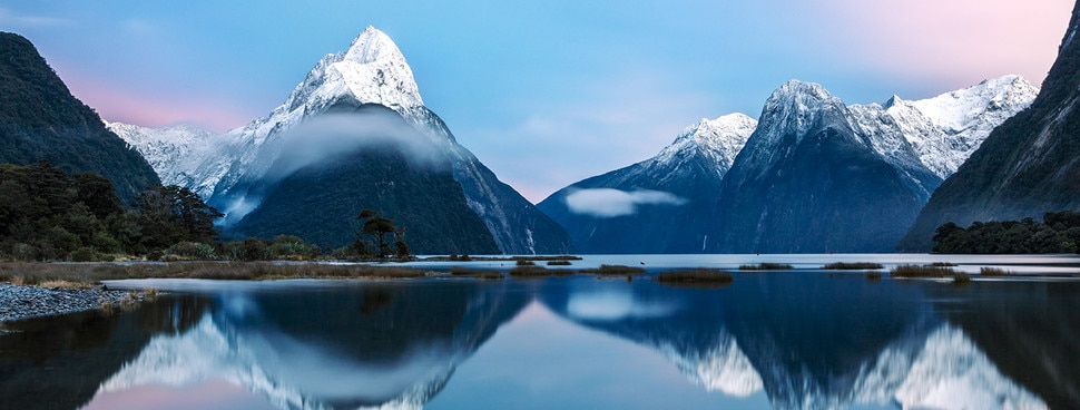nz-milfordsound-mountain-bluesky