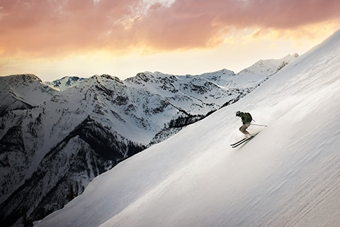 Man skiing down a slope in Canada