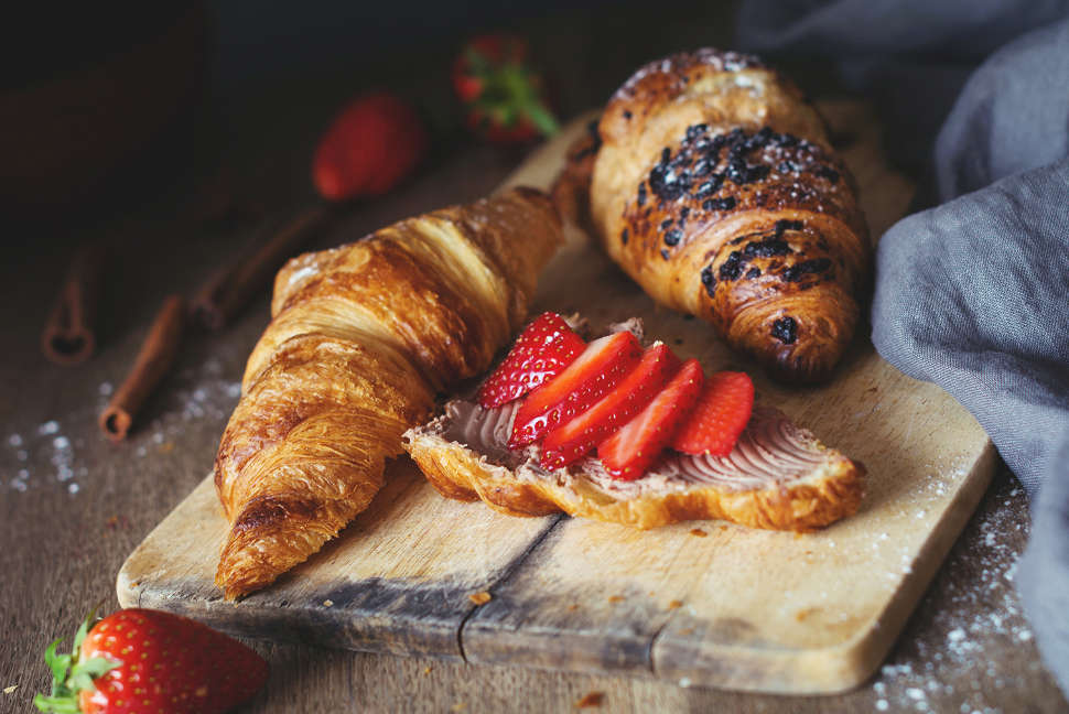 Croissants with chocolate cheese spread and fresh strawberries