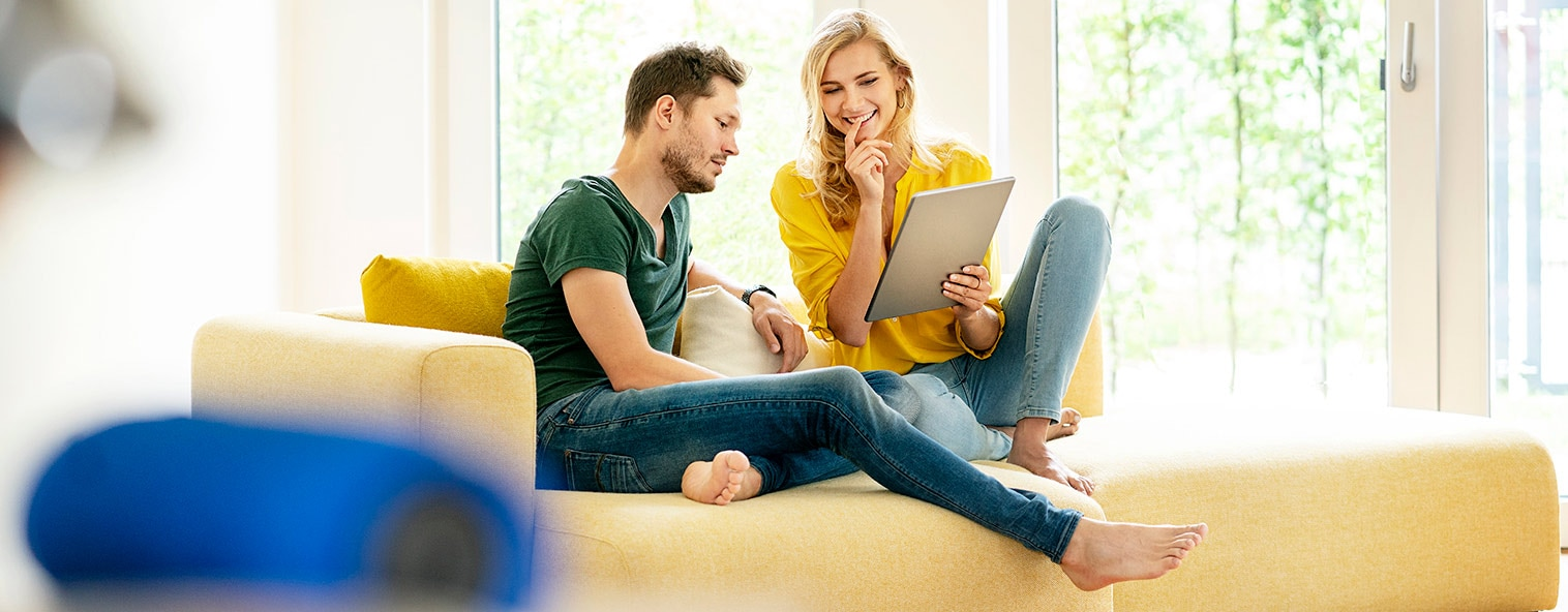 Couple with laptop looking to book online