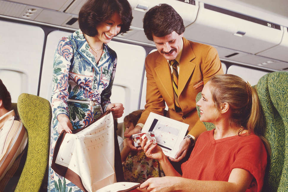 Qantas passenger shopping onboard flight in 1980s