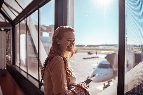 Lady at airport overlooking aerobridge
