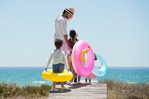 Family beachside with inflatables