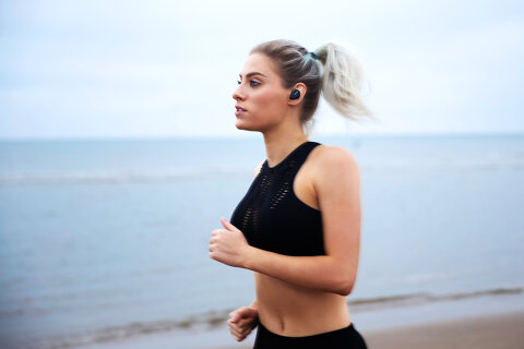 woman running with bose headphones