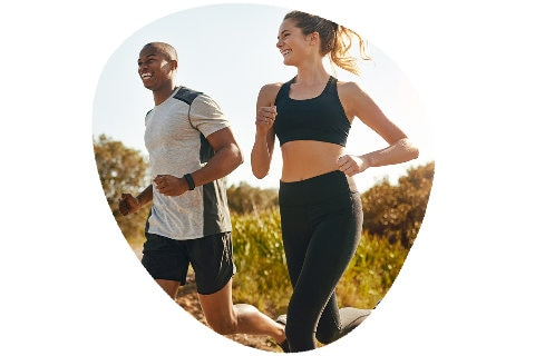 Couple in activewear exercising outdoors