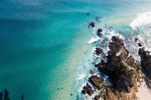 Aerial view of blue ocean and rocks