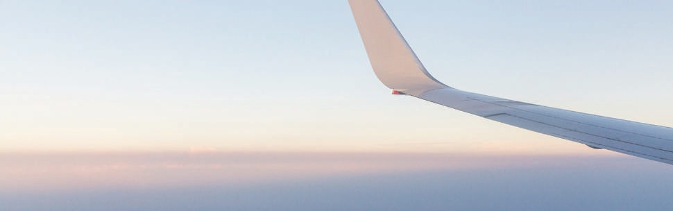 Qantas aircraft wing in open sky