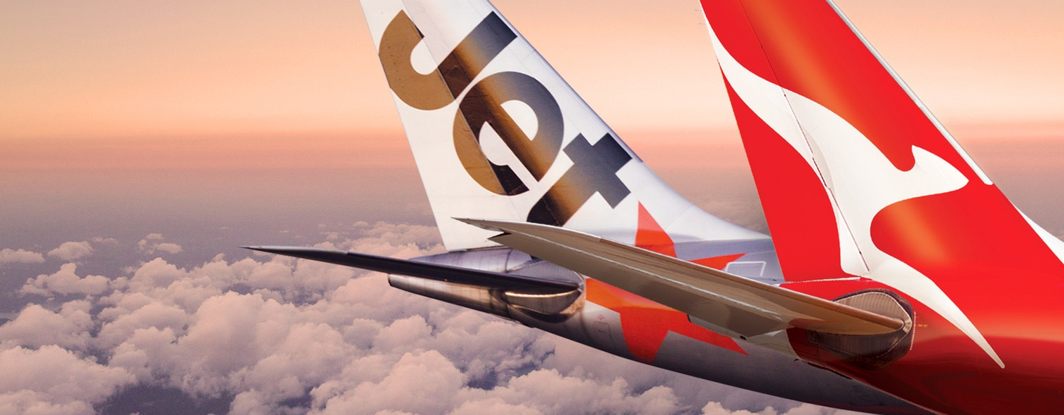 Qantas and Jetstar aircraft tails in the sky