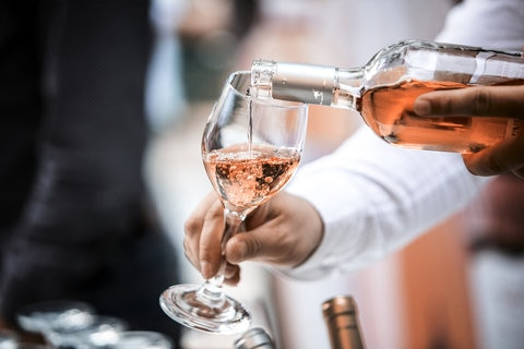 Rose wine being poured into a glass