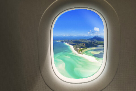 Aerial view of Whitsundays through an aircraft window
