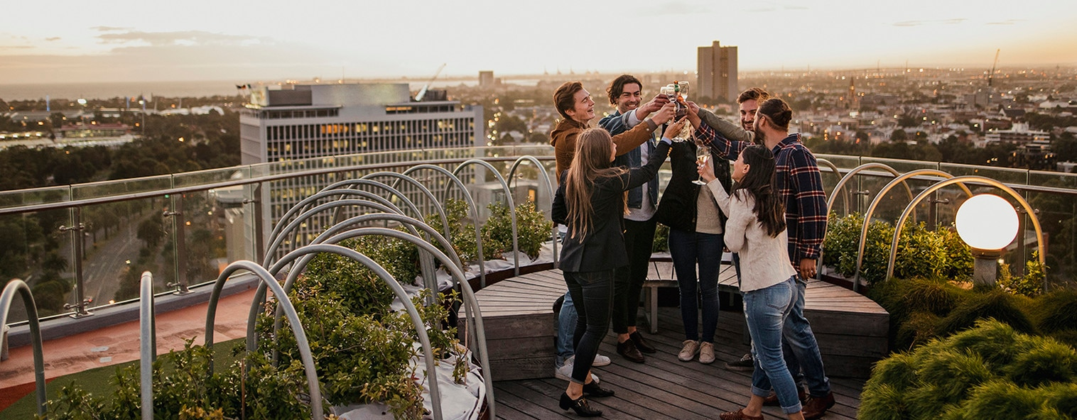 Friends enjoying wine on the rooftop